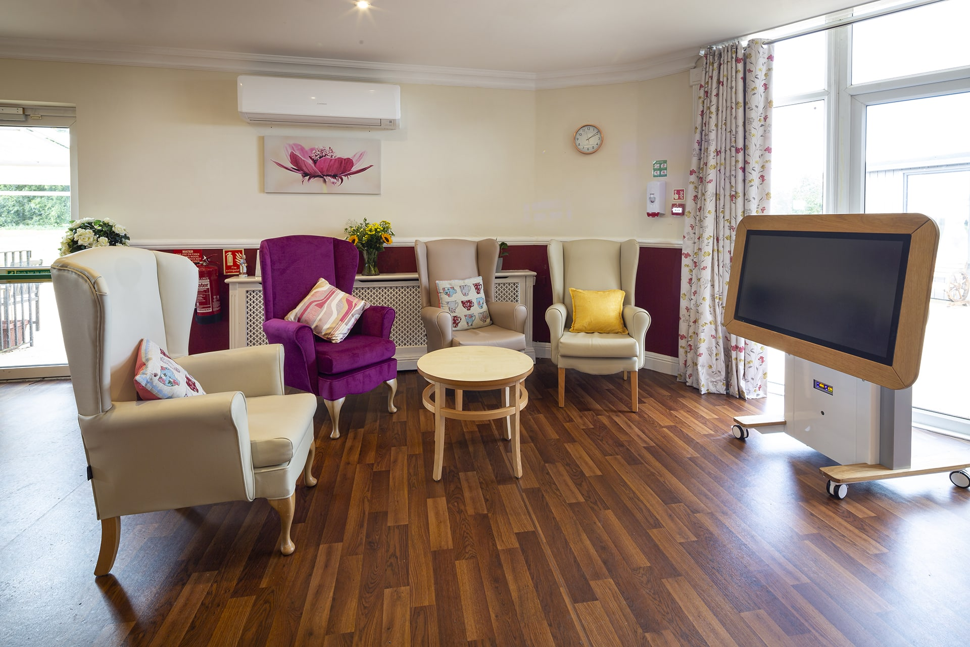 Stambridge Meadows Care Home lounge with giant interactive tablet