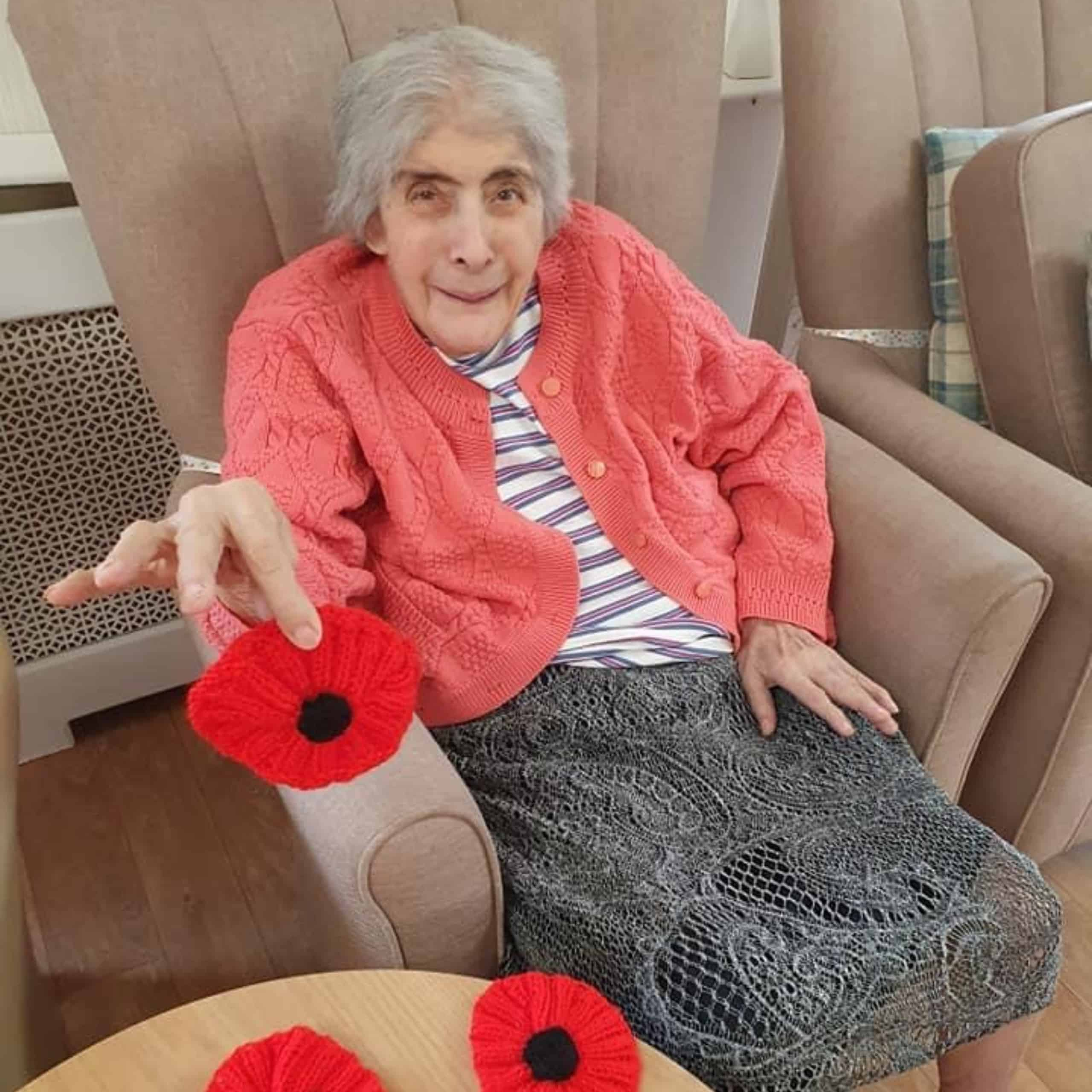 Whitby House care home resident Pauline Butterworth with her knitted poppies for the Royal British Legion.