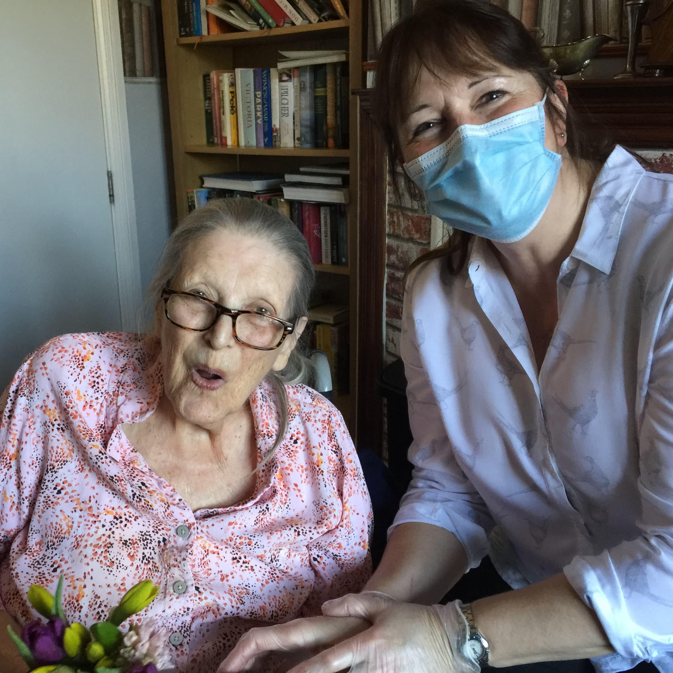 Dungate Manor Care Home resident Pamela Turner enjoying a visit from her daughter Deborah Pearle.