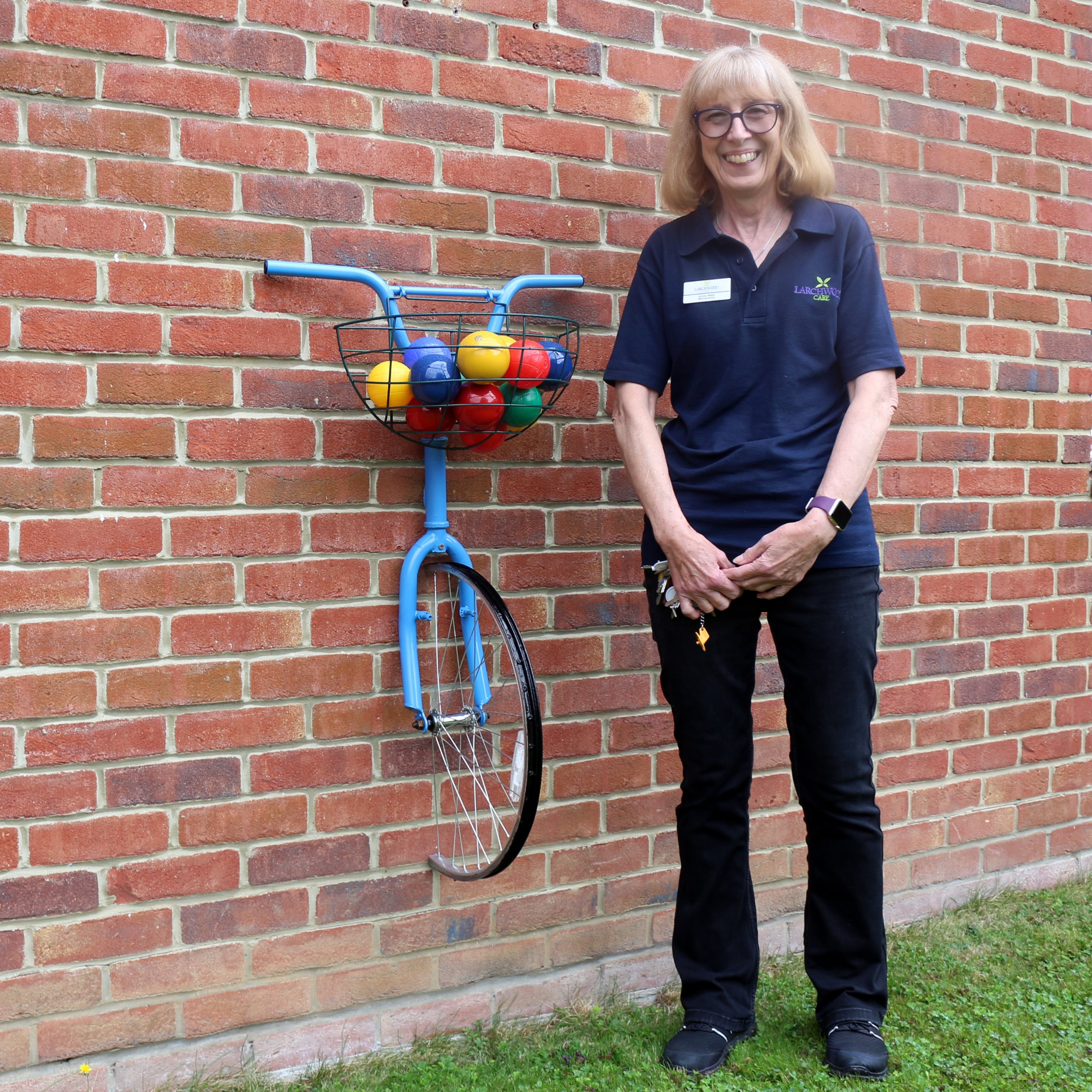 Wisbech care home maintenance person Janice Webb with her upcycled garden art at Dove Court.