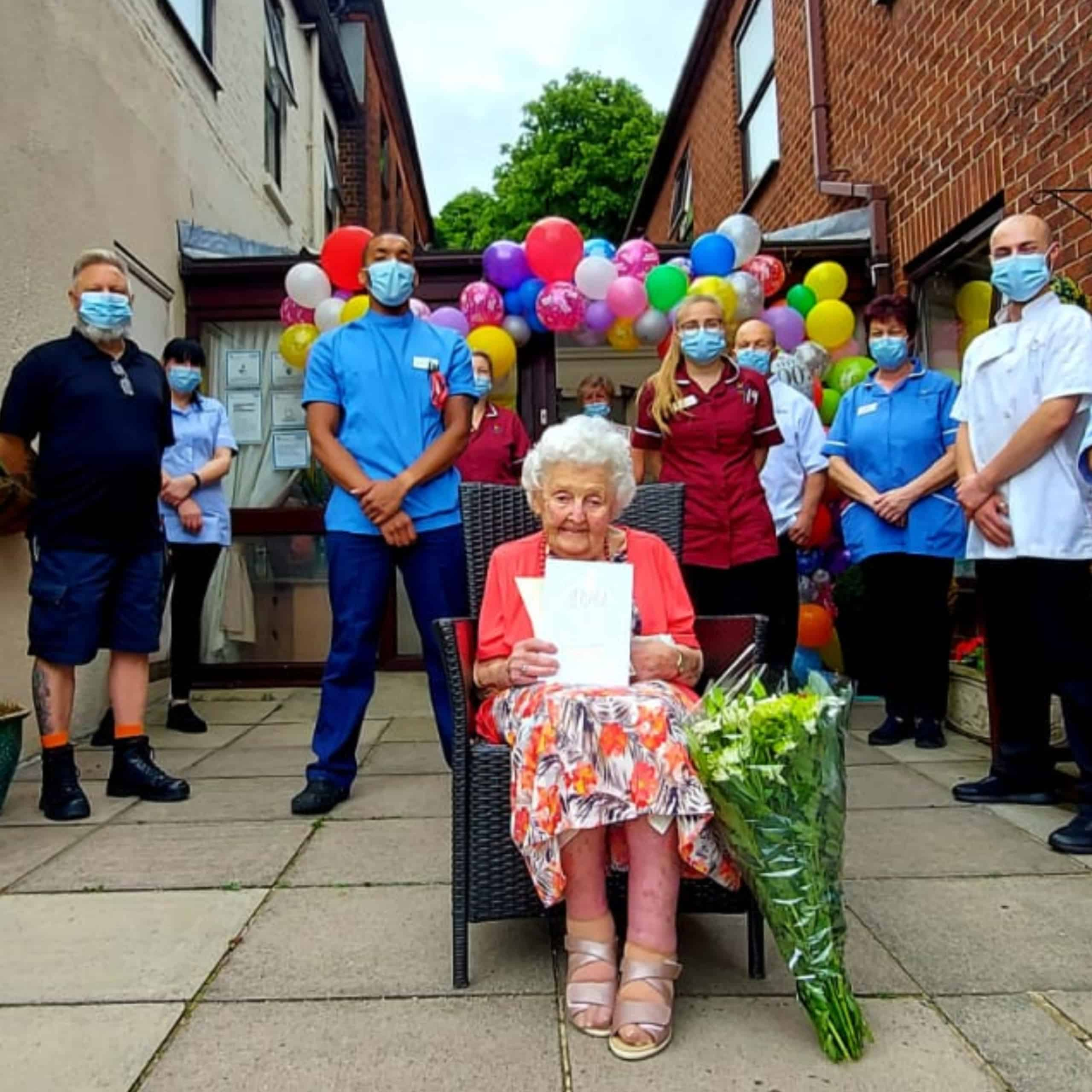 Norwich care home resident Ruby Baker with the guard of honour from Hillcrest Care Home.