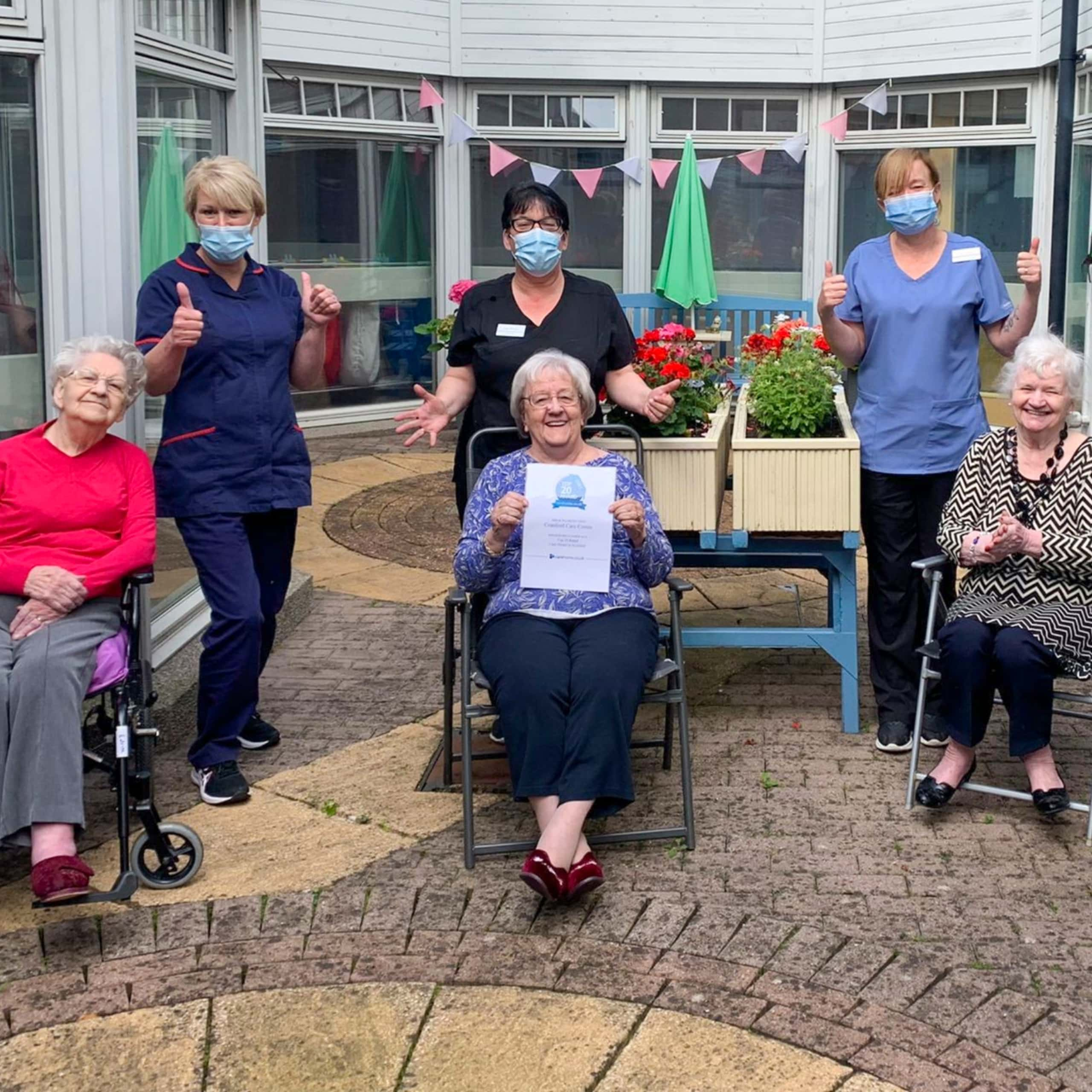 Staff and residents at Aberdeen care home Cranford with their Carehome.co.uk Top 20 Award Certificate.