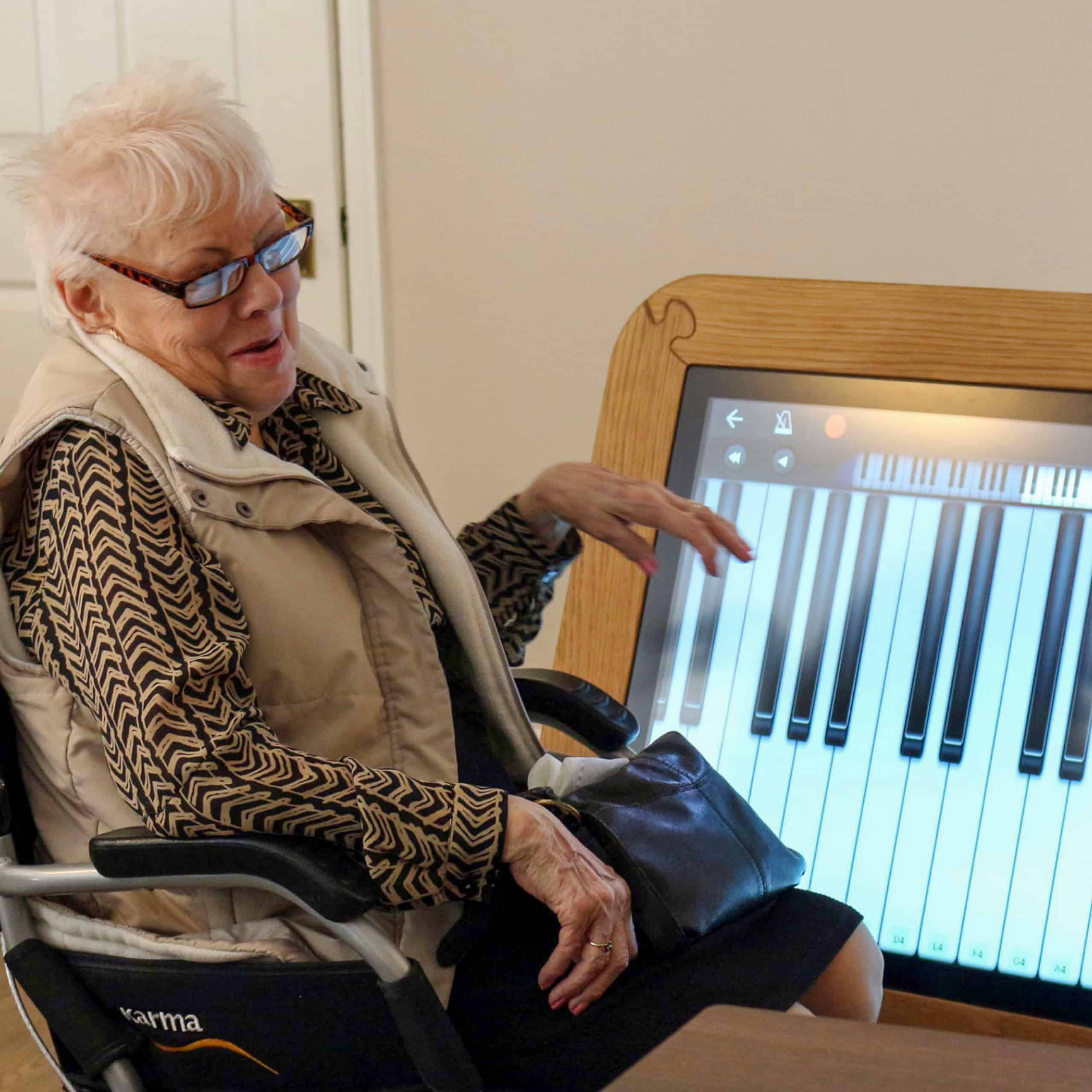 Great Horkesley Manor resident Shirley Wyncoll with the giant interactive table at the care home in Colchester.