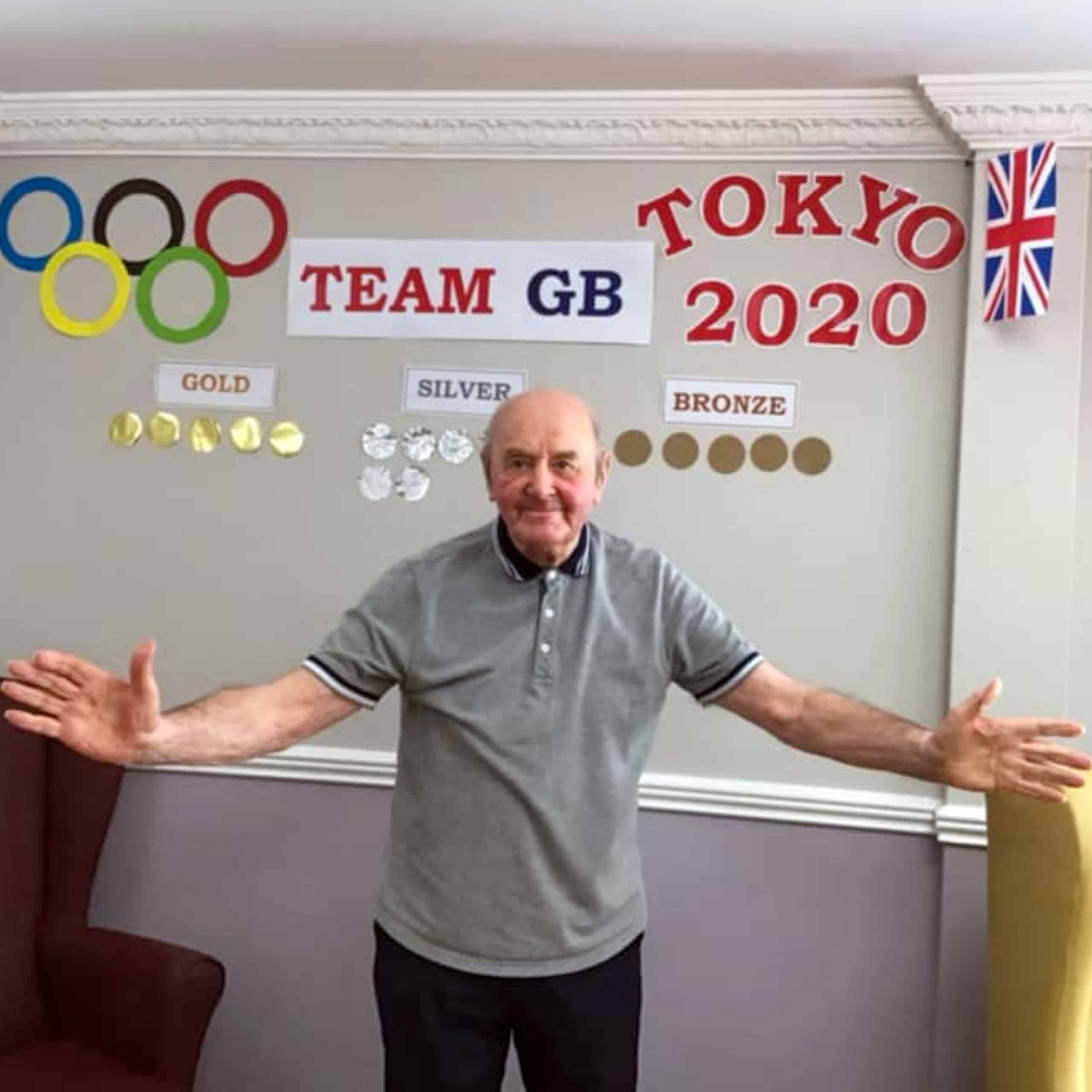 Ken, a resident of Willenhall care home Swan House with the home's Team GB medal board.